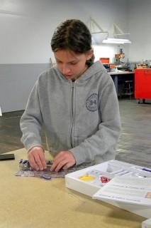 Girl Making Snap Circuits