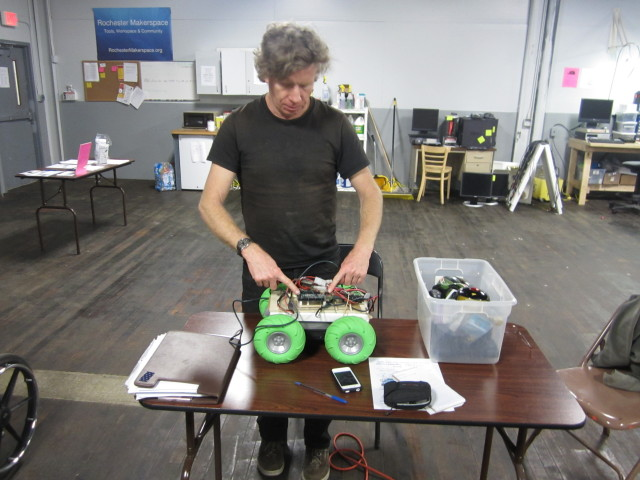 Paul Flavin works on a remote control car that will run on the Arduino. Flavin moderates a group on the Arduino on Thursday nights at the Makerspace.